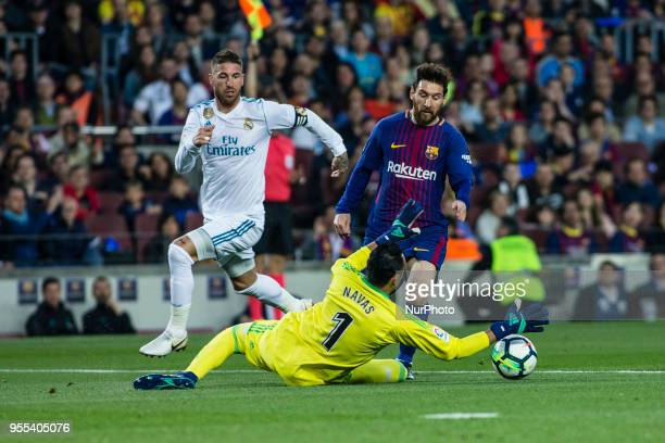 10 Leo Messi from Argentina of FC Barcelona in front of 01 Keylor Navas from Puerto Rico of Real Madrid during the La Liga derby football match...