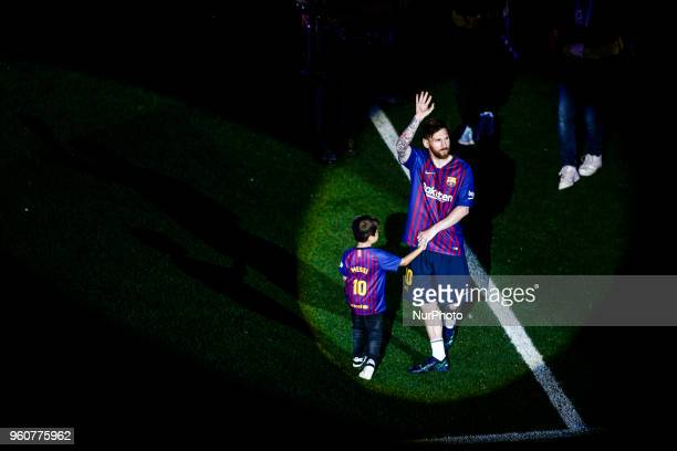 10 Leo Messi from Argentina of FC Barcelona with his children during the Andres Iniesta farewell at the end of the La Liga football match between FC...