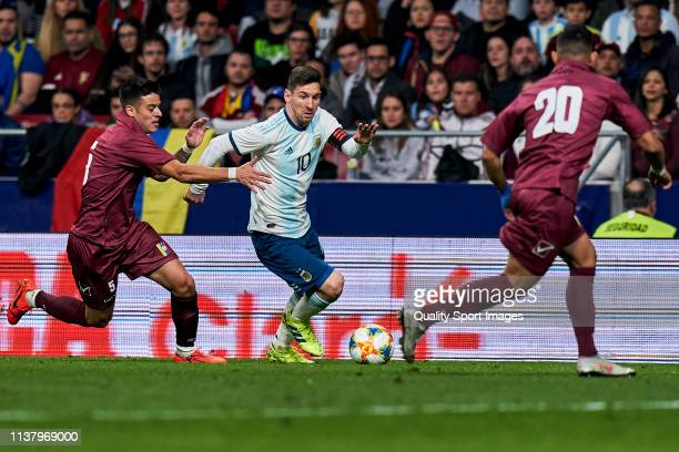 Leo Messi of Argentina competes for the ball with Junior Moreno of Venezuela during the international friendly match between Argentina and Venezuela...