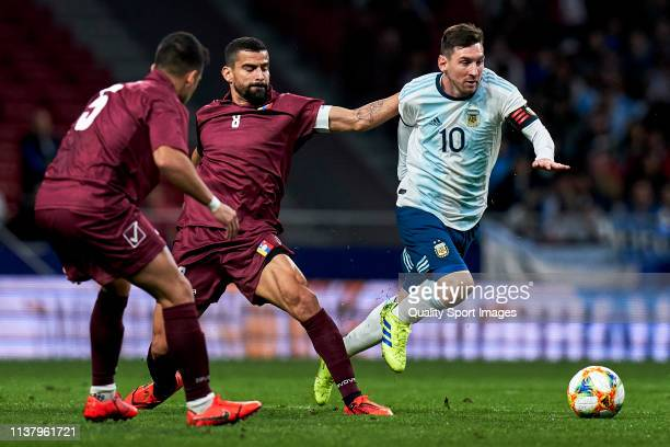 Leo Messi of Argentina competes for the ball with Tomas Rincón o Venezuela in the international friendly match between Argentina and Venezuela at...