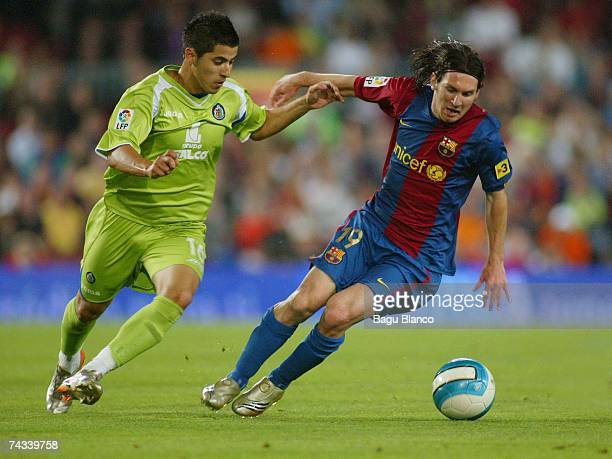 Leo Messi of Barcelona and Albin of Getafe run in action during the match between FC Barcelona and Getafe of La Liga on May 26 2007 at the Camp Nou...