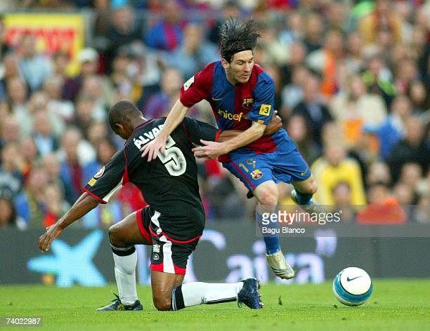 Leo Messi of Barcelona and Alvaro of Levante in action during the match between FC Barcelona and Levante of La Liga on April 29 played at the Camp...
