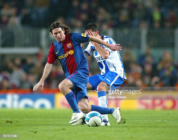 Leo Messi of Barcelona and Capdevila of Deportivo compete for the ball during the match between FC Barcelona and Deportivo de la Coruna of La Liga at...