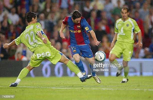 Leo Messi of Barcelona and Casquero of Getafe are seen in action during the match between FC Barcelona and Getafe of La Liga on May 26 2007 at the...