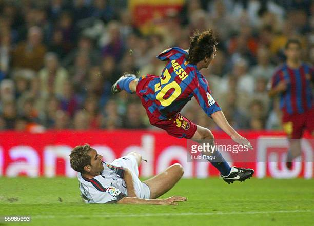 Leo Messi of Barcelona and Cesar Cruchaga of Osasuna in action during the match between FC Barcelona and Osasuna of the Spanish Primera Liga on...