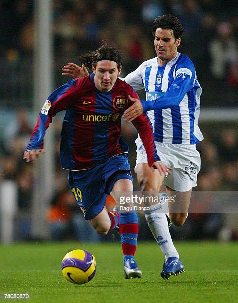 Leo Messi of Barcelona and Hipolito Poli of Recreativo in action during the La Liga match between FC Barcelona and Recreativo de Huelva played at the...