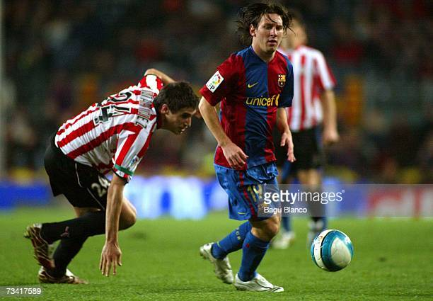 Leo Messi of Barcelona and Javi Martinez of Athletic run during the match between FC Barcelona and Athletic Club de Bilbao of La Liga at the Camp Nou...