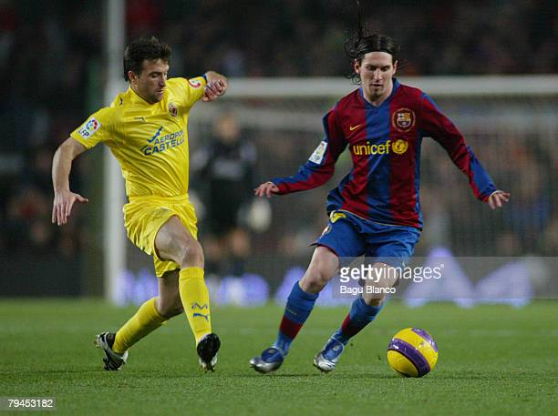 Leo Messi of Barcelona and Josico of Villarreal are shown in action during the Copa del Rey's match between FC Barelona and Villarreal at Camp Nou...