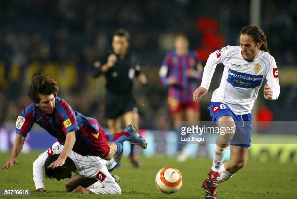 Leo Messi of Barcelona and Milito of Zaragoza in action during the match between FC Barcelona and Real Zaragoza, of Spain Cup on February 1, 2006 at...