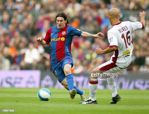 Leo Messi of Barcelona and Nunes of Mallorca in action during the La Liga match between FC Barcelona and Mallorca on April 15 played at the Camp Nou...