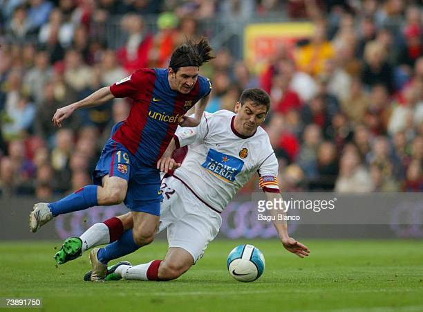 Leo Messi of Barcelona and Sergio Ballesteros of Mallorca in action during the La Liga match between FC Barcelona and Mallorca on April 15 played at...