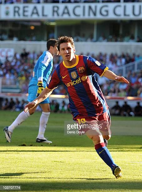Leo Messi of Barcelona celebrates after scoring Barcelona's first goal during the La Liga match between Racing Santander and Barcelona at El...