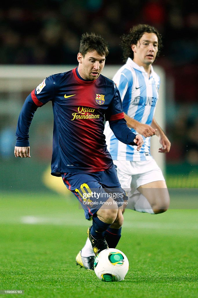 Leo Messi (L) of Barcelona FC competes for the ball with Manuel Ronaldo Iturra (R) of Malaga CF during the Copa del Rey Quarter Final match between Barcelona FC and Malaga CF at Camp Nou on January 16, 2013 in Barcelona, Spain.