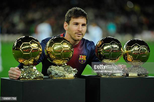 Leo Messi of Barcelona FC displays his four ballons d'or to the audience prior to the Copa del Rey Quarter Final match between Barcelona FC and...