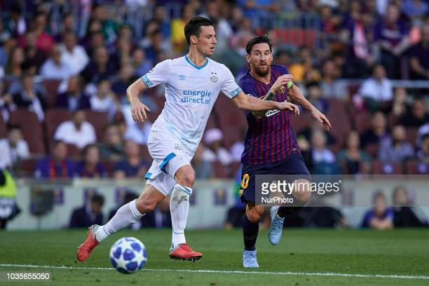 Leo Messi of FC Barcelona compete for the ball with Nick Viergever of PSV Eindhoven during the UEFA Champions League group B match between FC...