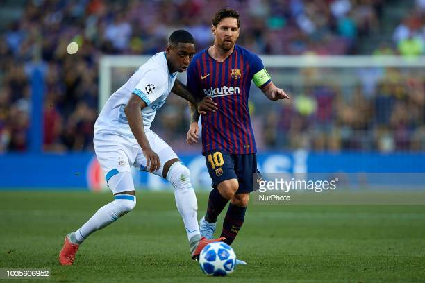 Leo Messi of FC Barcelona competes for the ball with Pablo Rosario of PSV Eindhoven during the UEFA Champions League group B match between FC...