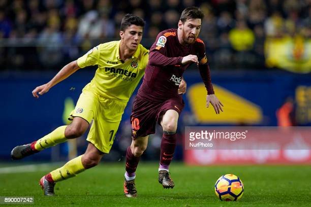 Leo Messi of FC Barcelona competes for the ball with Rodrigo of Villarreal CF during the La Liga game between Villarreal CF and FC Barcelona at...
