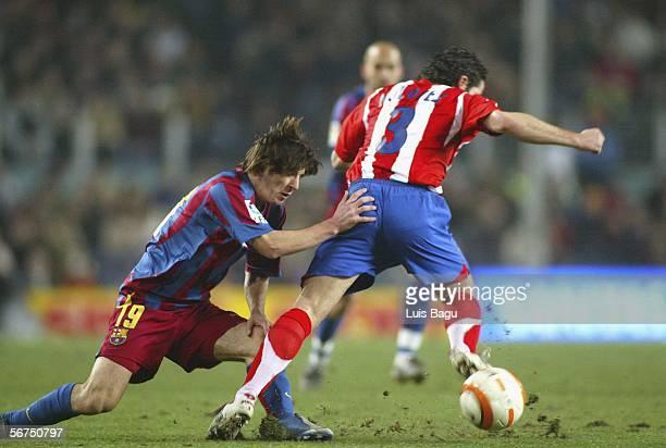 Leo Messi of FC Barcelona competes with Antonio Lopez of Atletico Madrid during the La Liga match between FC Barcelona and Atletico Madrid at the...