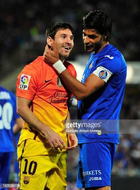 Leo Messi of FC Barcelona jokes with Miguel Torres of Getafe CF during the La Liga match between Getafe CF and FC Barcelona at Coliseum Alfonso Perez...