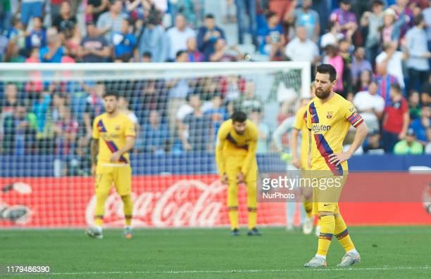 Leo Messi of FC Barcelona reacts after goal of Levante during the La Liga Santander match between Levante and FC Barcelona at Estadio Ciutat de...