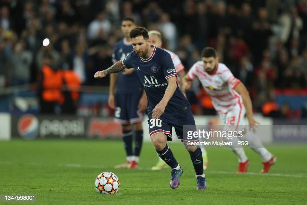 Leo Messi of Paris Saint-Germain kicks a penalty during the UEFA Champions League group A match between Paris Saint-Germain and RB Leipzig at Parc...