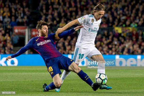Leo Messi vies with Modric' during the spanish football league La Liga match between FC Barcelona and Real Madrid at the Camp Nou Stadium in...