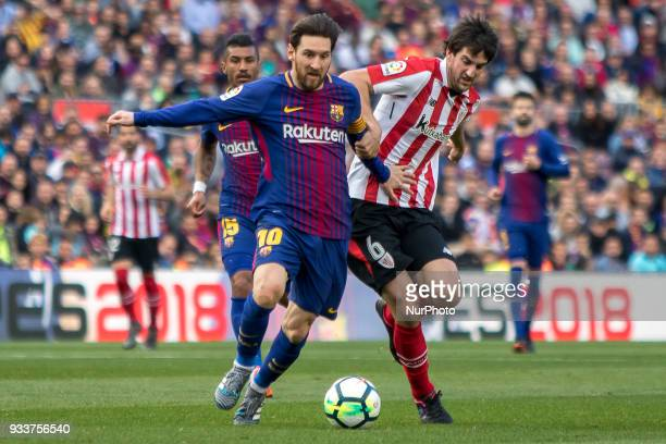 Leo Messi vies with San Jose during the spanish league match between FC Barcelona and Athletic Club Bilbao at the Camp Nou Stadium in Barcelona...