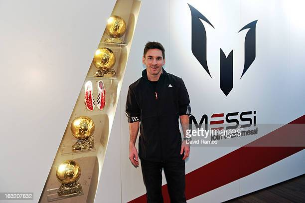 Leo Messi with his four successive FIFA Ballon d'Or trophies during his visit to the new adidas Messi Gallery on March 6 2013 in Barcelona Spain