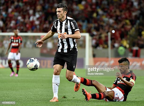 Leo Moiura of Flamengo struggles for the ball with Datolo of Atletico MG during a match between Flamengo and Atletico MG as part of Brasileirao...