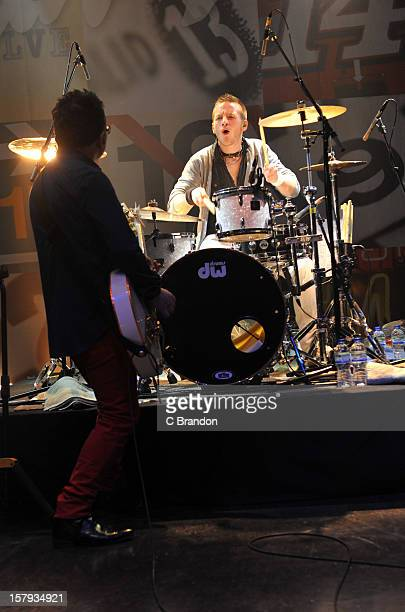 Leo Moran and Rickie O'Neill of The Saw Doctors perform on stage at O2 Shepherd's Bush Empire on December 7 2012 in London England