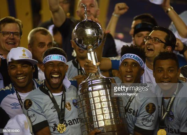Leo Moura and Bruno Cortez of Gremio raise the trophy after winning 2 to 1 in Copa Libertadores final match against Lanus at the Ciudad de Lanus...