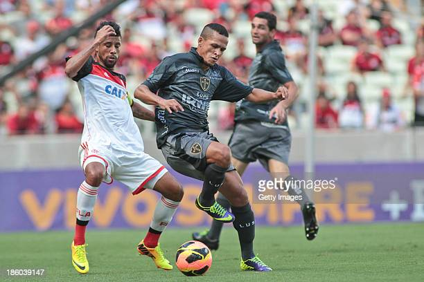 Leo Moura of Flamengo and Souza of Portuguesa in action during the match between Flamengo and Portuguese for the Brazilian Championship Serie A in...