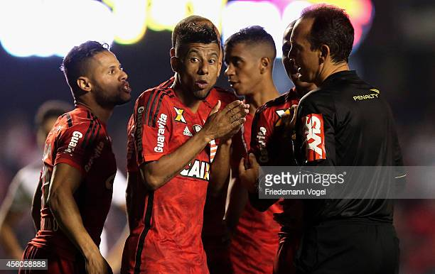 Leo Moura of Flamengo speaks with referee Andre Luiz de Freitas Castro during the match between Sao Paulo and Flamengo for the Brazilian Series A...