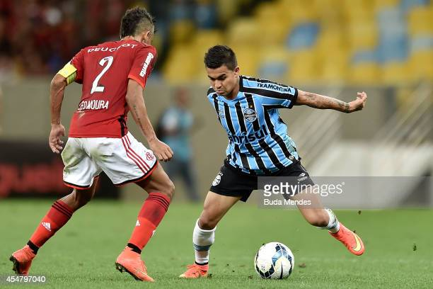 Leo Moura of Flamengo struggles for the ball with Dudu a of Gremio during a match between Flamengo and Gremio as part of Brasileirao Series A 2014 at...