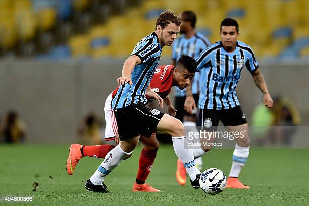 Leo Moura of Flamengo struggles for the ball with Lucas Coelho a of Gremio during a match between Flamengo and Gremio as part of Brasileirao Series A...