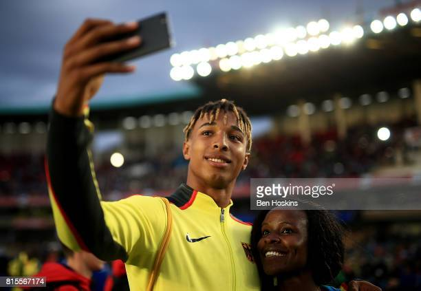 Leo Neugebauer of Germany poses for a selfie with a fan on day five of the IAAF U18 World Championships at The Kasarani Stadium on July 16 2017 in...