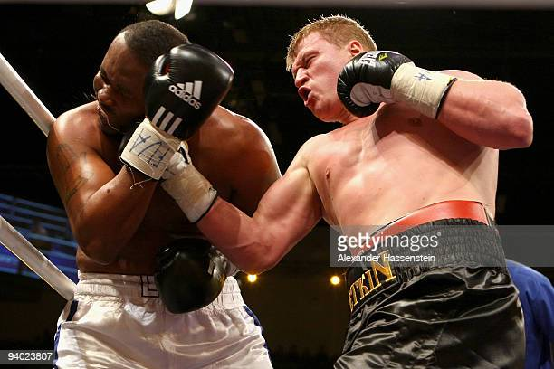 Leo Nolan of the US and Alexander Povetkin of Russia exchange punches during their Heavyweight fight at the Arena Ludwigsburg on December 5 2009 in...