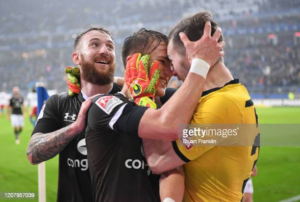 Leo Oestigard of St.Pauli celebrates with Robin Himmelmann at the end of the Second Bundesliga match between Hamburger SV and FC St. Pauli at...
