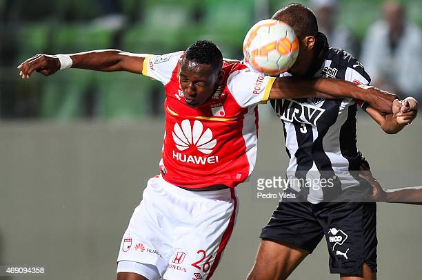 Leo of Atletico MG and Yerry Mina of Independiente Santa Fe battle for the ball during a match between Atletico MG and Independiente Santa Fe as part...