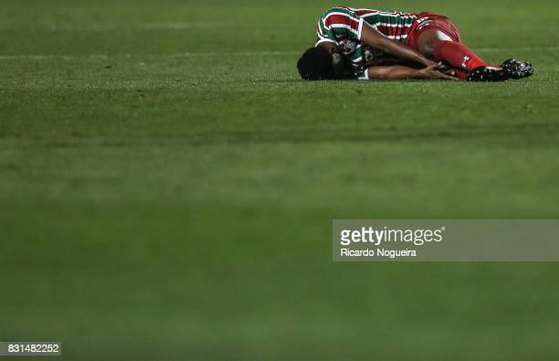 Leo of Fluminense goes down injured during the match between Santos and Fluminense as a part of Campeonato Brasileiro 2017 at Pacaembu Stadium on...
