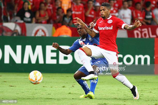 Leo of Internacional battles for the ball against Angel Mena of Emelec during match between Internacional and Emelec as part of Copa Bridgestone...