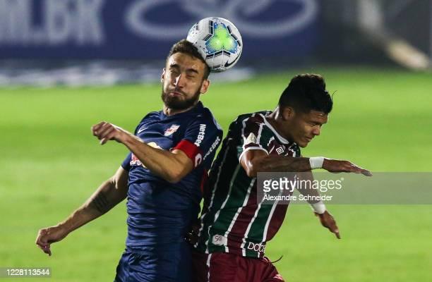 Leo Ortiz of Red Bull Bragantino heads the ball against Evanilson of Fluminense during the match between Red Bull Bragantino and Fluminense as part...