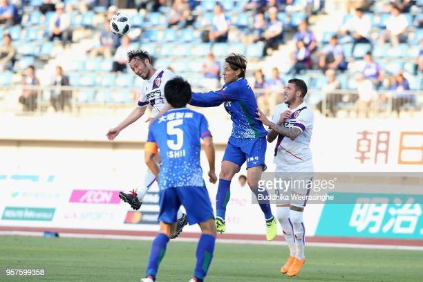 Leo Osaki of Tokushima Vortis competes for the ball against Marcus Tulio Tanaka and Renzo Lopez of Kyoto Sanga during the JLeague J2 match between...