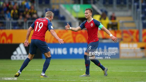 Leo Ostigard of Norway celebrates with teammate Erling Haland after scoring his team's third goal during the 2019 FIFA U20 World Cup group C match...