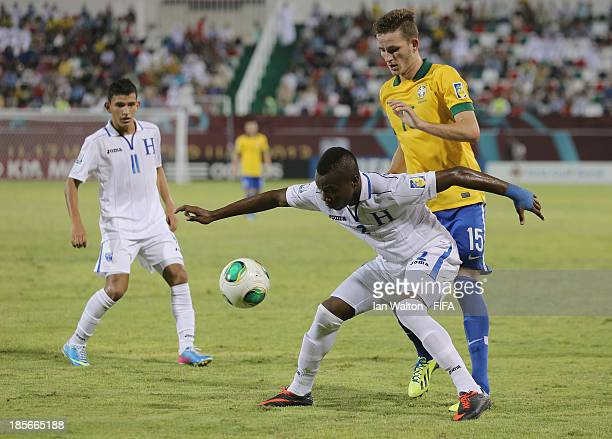 Leo Pereira of Brazil tries to tackle Kevin Alvarez of Honduras during the Group A FIFA U17 World Cup match between Honduras and Brazil at Ras Al...