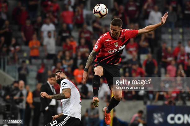 Leo Pinheiro of Brazil's Athletico Paranaense vies for the ball with Lucas Pratto of Argentina's River Plate during a Recopa Sudamericana 2019 first...