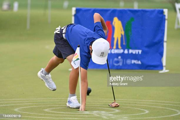 Leo Saito retrieves his ball after putting during the 2021 Drive, Chip and Putt Regional Qualifier at TPC Scottsdale on September 26, 2021 in...