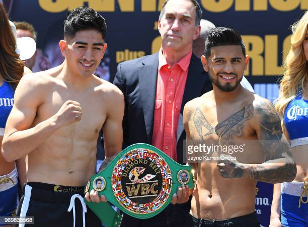 Leo Santa Cruz and Abner Mares pose at the weighin for their WBA Featherweight and WBC Diamond title fight against at Staples Center on June 8 2018...