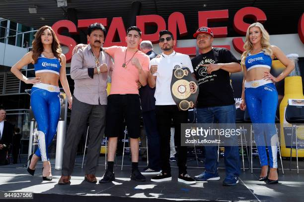 Leo Santa Cruz and Abner Mares pose for a photograph prior to a press conference on April 10 2018 in Los Angeles California