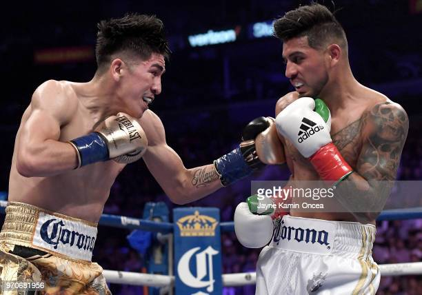 Leo Santa Cruz battles to defeat Abner Mares in their WBA Featherweight Title WBC Diamond Title fight at Staples Center on June 9 2018 in Los Angeles...
